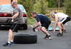 "Bob Raines-- Montgomery Media<br /> Fort Washington firefighters do ""frog hops"" in the back lot of the firehouse at one of their""boot camp"" physical training sessions."