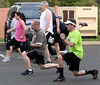 Bob Raines-- Montgomery Media<br /> Fort Washington firefighters do lunges at their bootcamp.