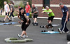 Bob Raines-- Montgomery Media<br /> Sharon Virgilio from Action Personal Training gets everybody stretched out at Firt Washington Fire Co. Bootcamp.
