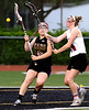 Bob Raines-Montgomery Media<br /> Kaitlyn Wallace checks the ball from Sydney Bachmayer's stick.