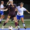 Avon Lake's Allie Heschel (42) kicks the ball away from Midview's Ellie Hoff (5) Oct. 7.  STEVE MANHEIM/CHRONICLE