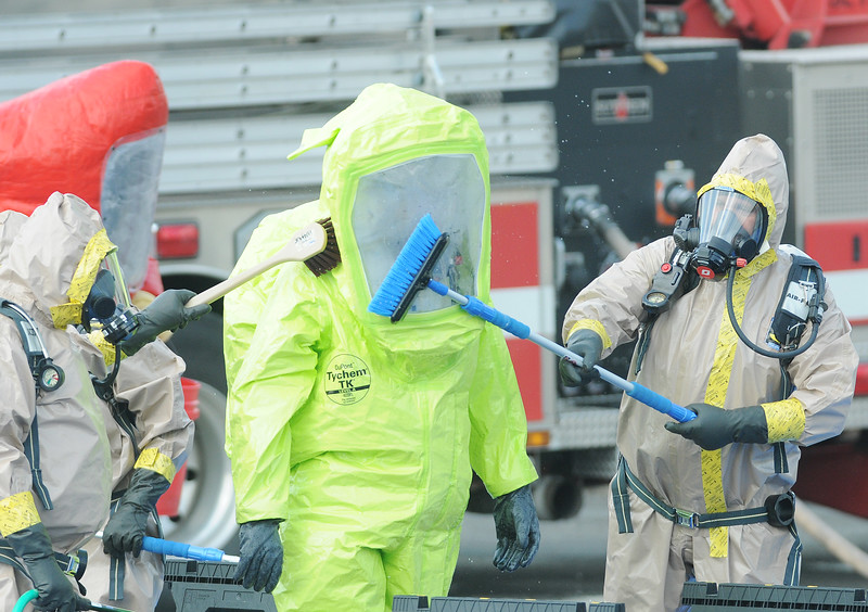 Jack Haley/Messenger Post Media<br /> Haz Mat specialist from several different counties were used in a chemical spill at Smart System Technology in Canandaigua on Wednesday.