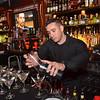 Bartender Jose Silva pours a martini at Destare Martini Bar in downtown Fitchburg. SENTINEL & ENTERPRISE / Ashley Green