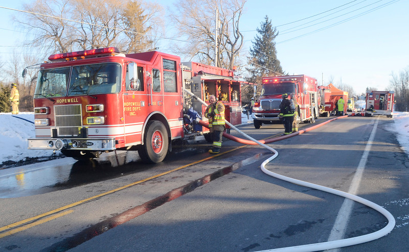 (Jack Haley/Messenger Post Media)<br /> Fire trucks lined up on County Road 47.
