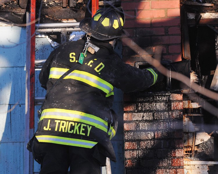 (Jack Haley/Messenger Post Media)<br /> A Seneca Castle firefighter checks an outside door on the chimney.