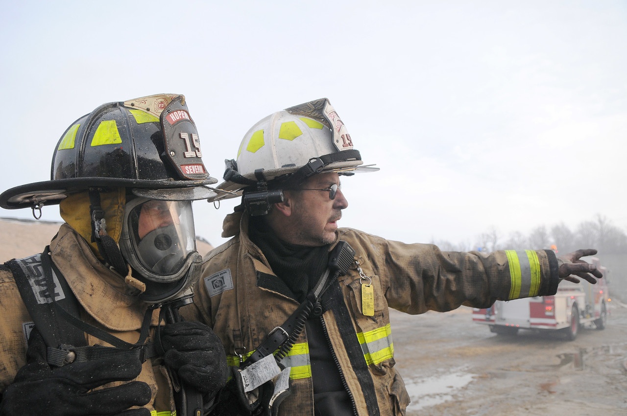 Jack Haley/Messenger Post Media<br /> Hopewell Asstaint Chief Steve Davis gives direction for Firefighter Serevino during the structure fire at Spring Hope Dairy on County Road 4.