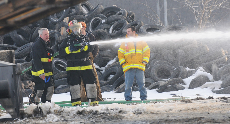Jack Haley/Messenger Post Media<br /> Firefighters use a hose on some sileage as it is taken out of the structure.