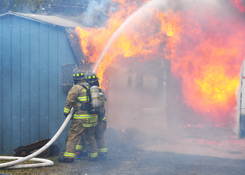 [Jack Haley/Messenger Post Media]<br /> Firefighters from Hopewell, Shortsville, Clifton Springs and Seneca Castle were on scene to battle a fully engulfed strurcture fire on Route 488 Wednesday afternoon.