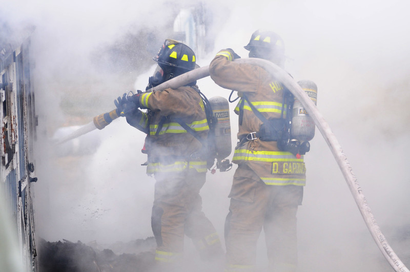 [Jack Haley/Messenger Post Media]<br /> Firefighters battled intense flames and smoke as they work to put out the blaze on Wednesday.