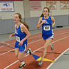 Leominster's Erin McDowell and Emma Cucchiara run the one-mile during the track meet at Fitchburg High on Thursday evening. SENTINEL & ENTERPRISE / Ashley Green