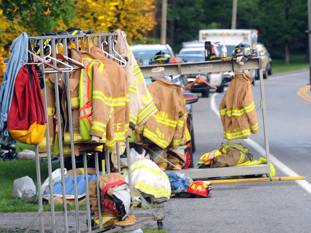 Jack Haley/Messenger Post Media<br /> Fire trucks and firefighter gear was removed the the burning building during the early morning fire.