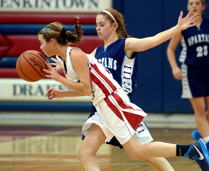 Jenkintown's Ashley Kremp works the ball around the top of the key looking for an opportunity guarded by Springfield's Bailey Krewson Tuesday, Dec. 30, 2014.<br /> Bob Raines-Digital First Media