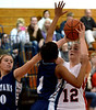 Jenkintown's Emma Dorshimer tries to force a shot past Springfield's Jayla Greene and Bailey Krewson Tuesday, Dec. 30, 2014.<br /> Bob Raines-Digital First Media