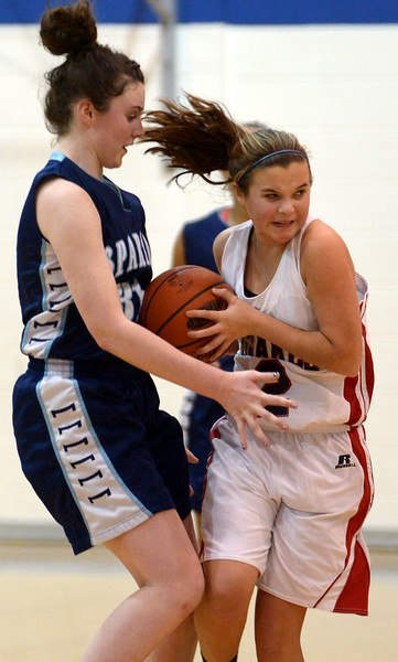 Springfield's Maura Ryan fouls Jenkintown's Jen Kremp Tuesday, Dec. 30, 2014.<br /> Bob Raines-Digital First Media