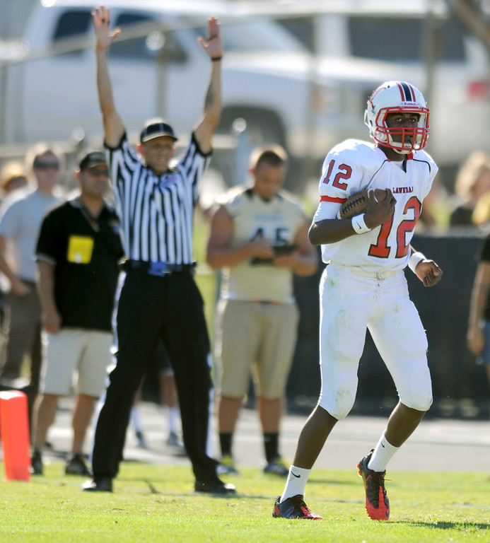 . Lawndale\'s quarterback Chris Murray scores a touchdown against Peninsula in Friday afternoon\'s high school football game in Rolling Hills Estates in CA. on September 27, 2013. (Photo by Sean Hiller/Daily Breeze)