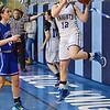 Lunenburg's Kayli Mathews keeps the ball in play during the game at Lunenburg on Friday evening. SENTINEL & ENTERPRISE / Ashley Green