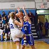 Leominster's Erin Stephenson attempts to block a shot by Lunenburg's Kayli Mathews during the game at Lunenburg on Friday evening. SENTINEL & ENTERPRISE / Ashley Green