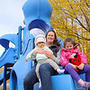 Jocelin Damien the treasure of the MOMS Club of Leominster sits with her daughters Julia, 8 months, and Madison, 4, at Dinosaur Park Playground in Leominster just off of Merriam Ave on Thursday afternoon. SENTINEL & ENTERPRISE/JOHN LOVE