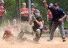North Penn catcher Jovanna Alfonsi comes up ready to throw after putting out Hatboro-Horsham's Dee Moyer at the plate during their game on Wednesday, May 13, 2015. (Bob Raines/Montgomery Media)