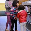 Sisters Alexa Fetzer, 7, Zoe Fetzer, 4, and Sofia Fetzer, 2, look for a movie in the Dr. Martin T. Feldman Children's Room at the Leominster Public Library on Wednesday morning. SENTINEL & ENTERPRISE/ JOHN LOVE