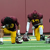 A few players bow their heads for pre-scrimmage player during the Minnesota Gopher Football scrimmage at TCF Stadium in Minneapolis on August 9, 2014.   (Pioneer Press: Sherri LaRose-Chiglo)