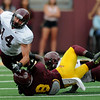 Minnesota Gophers wide receiver Isaac Fruechte is tackled by teammate defensive back Daletavious McGhee during the Minnesota Gopher Football scrimmage at TCF Stadium in Minneapolis on August 9, 2014.   (Pioneer Press: Sherri LaRose-Chiglo)