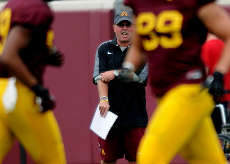 Minnesota Gophers Head Coach Jerry Kill rolls up his sleeves during the Minnesota Gopher Football scrimmage at TCF Stadium in Minneapolis on August 9, 2014.   (Pioneer Press: Sherri LaRose-Chiglo)