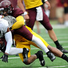 Minnesota Gophers linebacker Damien Wilson tackles teammate runningback David Cobb during the Minnesota Gopher Football scrimmage at TCF Stadium in Minneapolis on August 9, 2014.   (Pioneer Press: Sherri LaRose-Chiglo)
