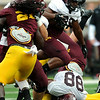 Minnesota Gophers Rodrick Williams Jr. gains some yardage as teammate Maxx Williams ends up upside down during the Minnesota Gopher Football scrimmage at TCF Stadium in Minneapolis on August 9, 2014.   (Pioneer Press: Sherri LaRose-Chiglo)