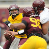 Minnesota Gophers defensive tackle Steven Richardson looks to tackle teammate and quarterback Chris Streveler during the Minnesota Gopher Football scrimmage at TCF Stadium in Minneapolis on August 9, 2014.   (Pioneer Press: Sherri LaRose-Chiglo)