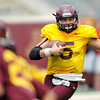 Minnesota Gophers quarterback Chris Streveler gains a few yards during the Minnesota Gopher Football scrimmage at TCF Stadium in Minneapolis on August 9, 2014.   (Pioneer Press: Sherri LaRose-Chiglo)