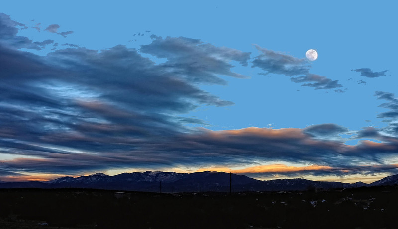 Full moon rising on the road from Santa Fe to Red River