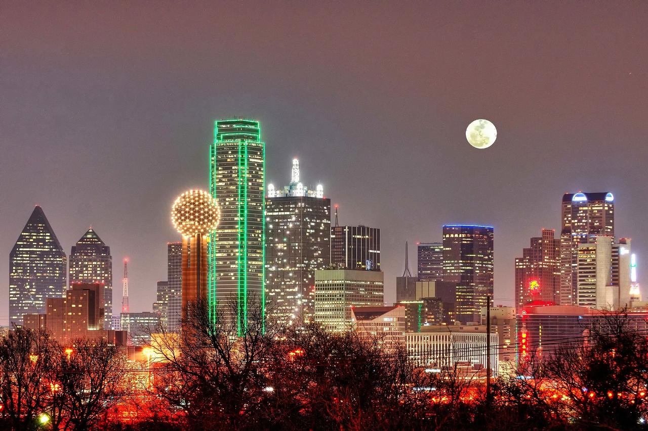 Dallas skyline with full moon rising