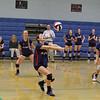 North Middlesex player #14 Kristina Osborne sets the ball at Thursday nights playoff game. SENTINEL & ENTERPRISE/JOHN LOVE