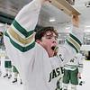 Nashoba Regional High School Hockeyplayer Hunter Boudreau lifts the trophy up for the fans. SENTINEL & ENTERPRISE/JOHN LOVE