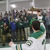 Nashoba Regional High School Hockey player P.J. Anastas lifts the trophy up as the fans cheer for the team. SENTINEL & ENTERPRISE/JOHN LOVE