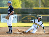 Bob Raines--Montgomery Media<br /> Lansdale Catholic's Kyle Diseroad slides into second base for a double as North Penn's John Posavec waits for the throw May 8, 2015.