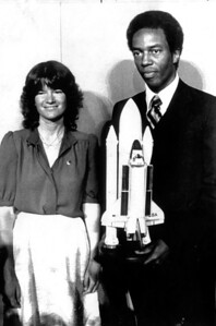Astronauts Sally Ride and Guion Bluford with model of the Shuttle, pose for photographers on 4/29/82.   L.A. Daily News file photo