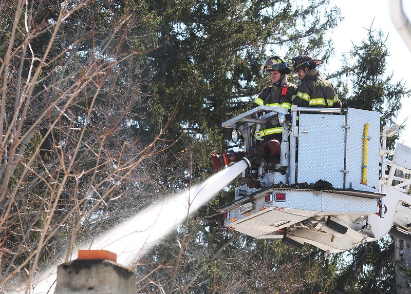 [Jack Haley/Messenger Post Media]<br /> Firefighters hit hot spots to ensure the fire is completly out on West Jackson Street in Palmyra.