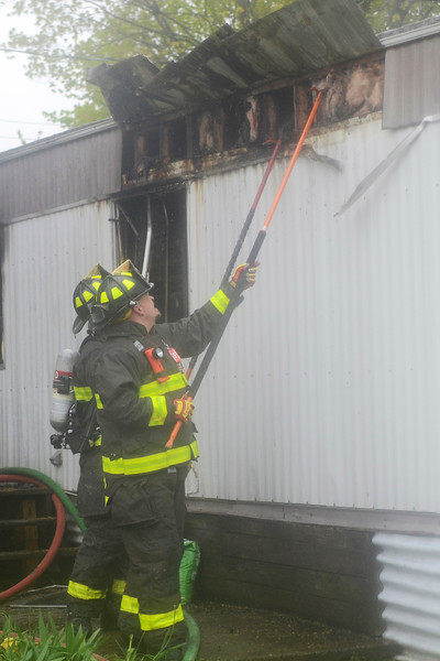(Jack Haley/Messenger Post Media)<br /> The Phelps Fire Department and Oaks Corners Fire Department's were disptached for a structure fire late Monday afterrnoon in a trailer on Bear Road in the Town of Phelps. Also disptached to the scene was Clifton Springs, Seneca Castle, and Northside.