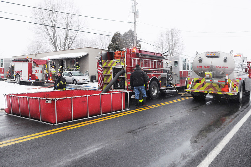 [Jack Haley/Messenger Post Media]<br /> A portable pond was set up for a tanker relay to supply a water source for Phelps and Oaks Corners firefighters Wednesday afternoon.