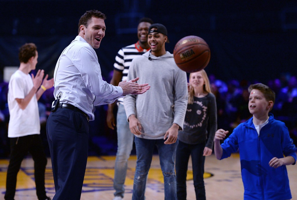 . Head Coach of the Los Angeles Lakers Luke Walton, center, Los Angeles Laker Julius Randle and Los Angeles Laker D\'Angelo Russell on the court with fans, during  The Los Angeles Sports & Entertainment Commission (LASEC) 13th annual LAKERS ALL-ACCESS, at the Staples Center.   Los Angeles  Calif., Monday, February ,27, 2017.            ( Photo by Stephen Carr / Daily News / SCNG )