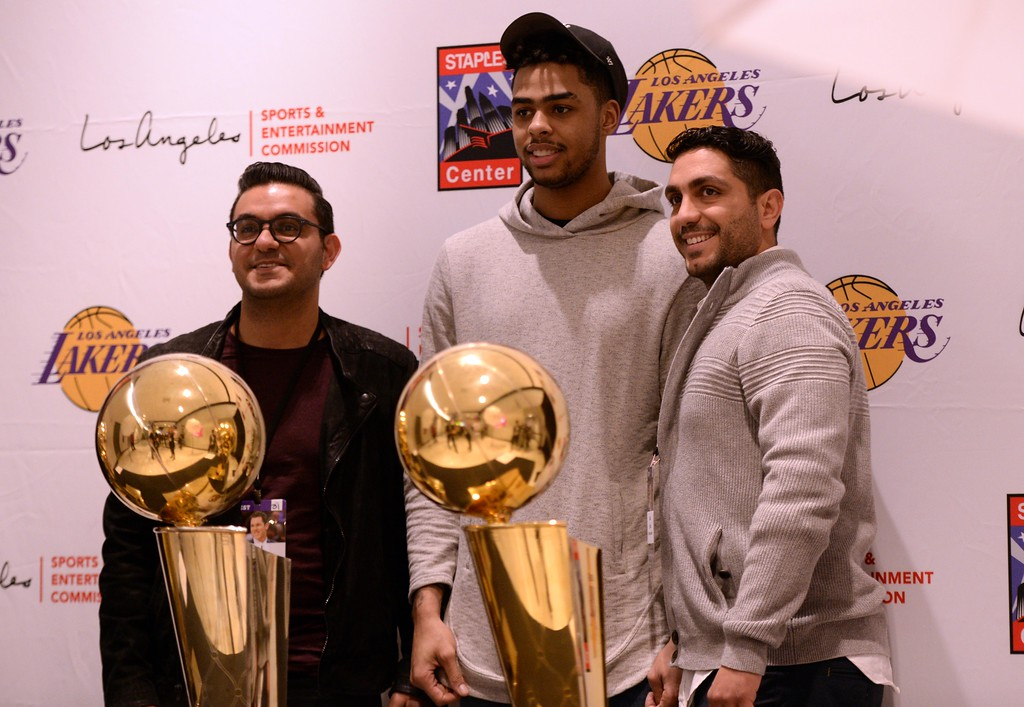 . Los Angeles Laker D\'Angelo Russell  poses for a photo with Laker fans and brothers Benjamin Eghbali,left, and Babak Eghbali of Los Angeles Calif., during The Los Angeles Sports & Entertainment Commission (LASEC) 13th annual LAKERS ALL-ACCESS, at the Staples Center.   Los Angeles  Calif., Monday, February ,27, 2017.            ( Photo by Stephen Carr / Daily News / SCNG )