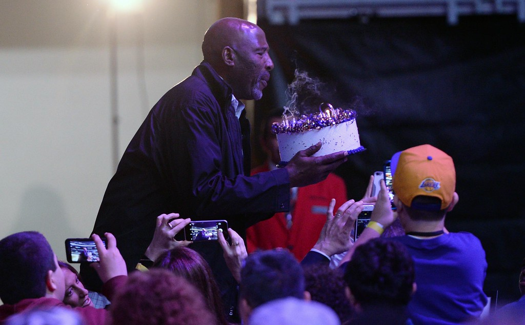 . Los Angeles Laker great James Worthy blows out the candles on his birthday cake after the crowd sang him happy birthday, during The Los Angeles Sports & Entertainment Commission (LASEC) 13th annual LAKERS ALL-ACCESS, at the Staples Center.   Los Angeles  Calif., Monday, February ,27, 2017.            ( Photo by Stephen Carr / Daily News / SCNG )