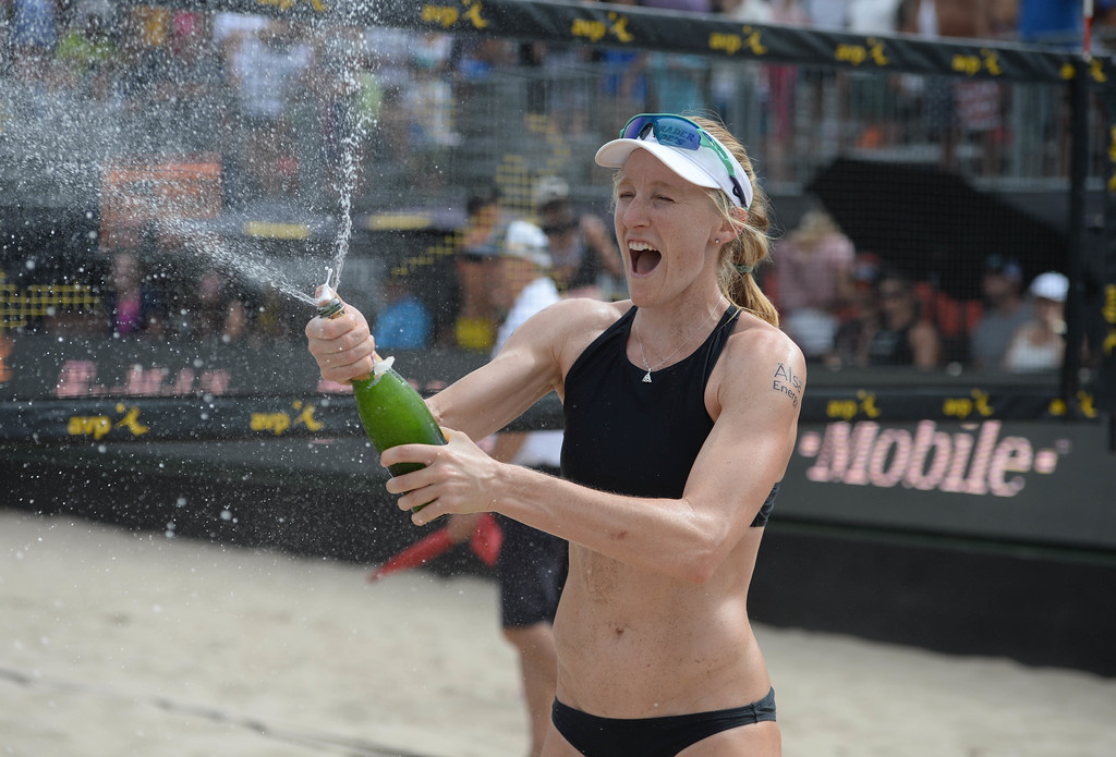 . Emily Day celebrates after her and her partner Brittany Hochevar won the AVP Hermosa Beach Women\'s Championship match, at Hermosa Beach, winning 21-17, 21-13 over Angela Bensend and her partner Geena Urango.    Hermosa Beach, Sunday, July 23, 2017.            ( Photo by Stephen Carr /  Daily Breeze / SCNG )