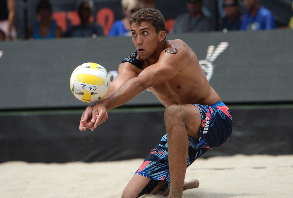 . Trevor Crabb dives for the ball during the AVP Hermosa Beach Men\'s Championship match, at Hermosa Beach. Tevor\'s brother Taylor Crabb and his partner Jake Gibb won 21-16,17-21,15-11, over he and his partner Sean Rosenthal.    Hermosa Beach, Sunday, July 23, 2017.            ( Photo by Stephen Carr /  Daily Breeze / SCNG )
