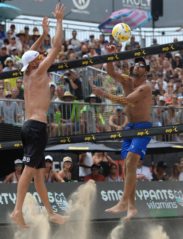 . Jake Gibb,left, goes up against Sean Rosenthal, during the AVP Hermosa Beach Men\'s Championship match, at Hermosa Beach.  ake Gibb and his partner Taylor Crabb won 21-16,17-21,15-11, over Trevor\'s brother Trevor Crabb and his partner Sean Rosenthal.    Hermosa Beach, Sunday, July 23, 2017.            ( Photo by Stephen Carr /  Daily Breeze / SCNG )