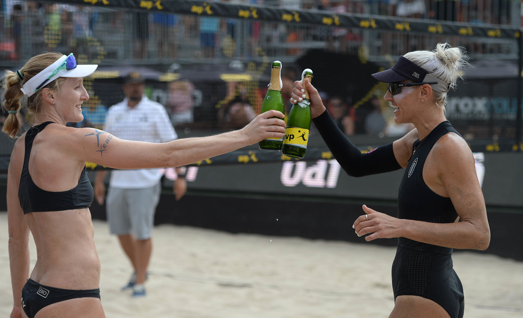. Emily Day,left, and her partner Brittany Hochevar celebrate after winning the AVP Hermosa Beach Women\'s Championship match, at Hermosa Beach, winning 21-17, 21-13 over Angela Bensend and her partner Geena Urango.    Hermosa Beach, Sunday, July 23, 2017.            ( Photo by Stephen Carr /  Daily Breeze / SCNG )