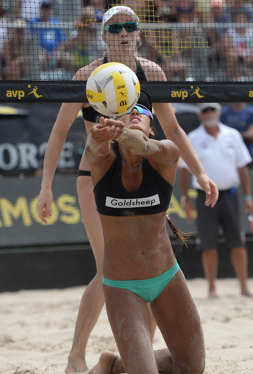 . Geena Urango dives for the ball against Emily Day,  during the AVP Hermosa Beach Women\'s Championship match, at Hermosa Beach. Emily Day and her partner Brittany Hochevar won 21-17, 21-13.     Hermosa Beach, Sunday, July 23, 2017.            ( Photo by Stephen Carr /  Daily Breeze / SCNG )