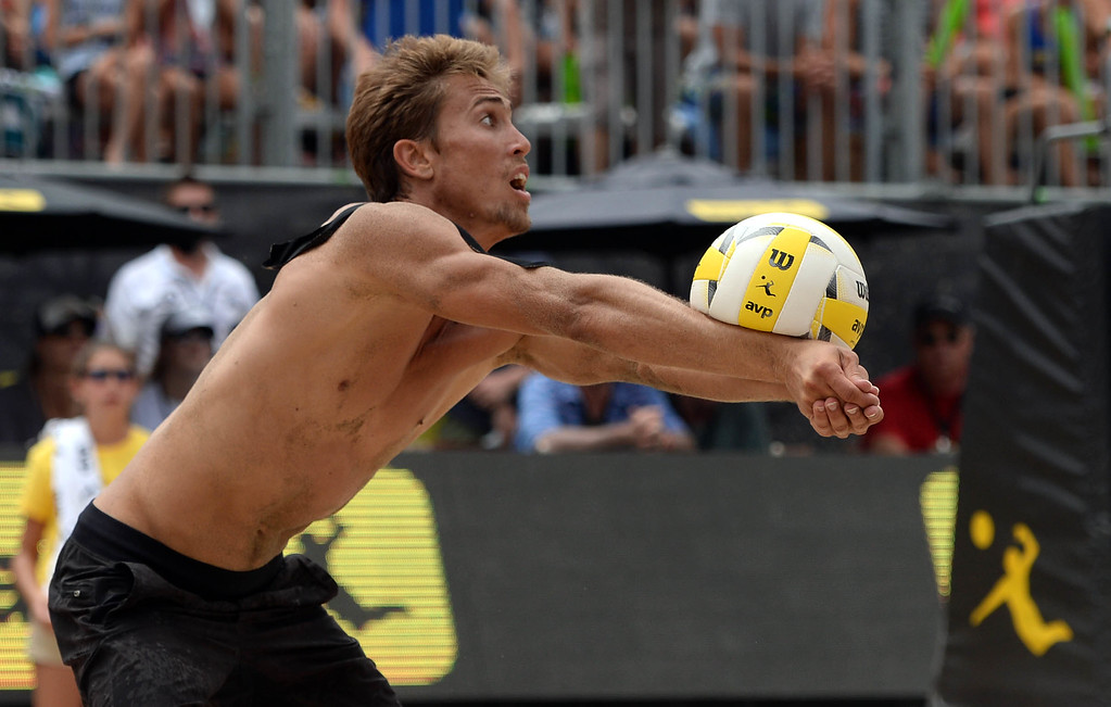 . Taylor Crabb dives for the ball during the AVP Hermosa Beach Men\'s Championship match, at Hermosa Beach. Taylor Crabb and his partner Jake Gibb won 21-16,17-21,15-11, over Taylor\'s brother Trevor Crabb and his partner Sean Rosenthal.    Hermosa Beach, Sunday, July 23, 2017.            ( Photo by Stephen Carr /  Daily Breeze / SCNG )